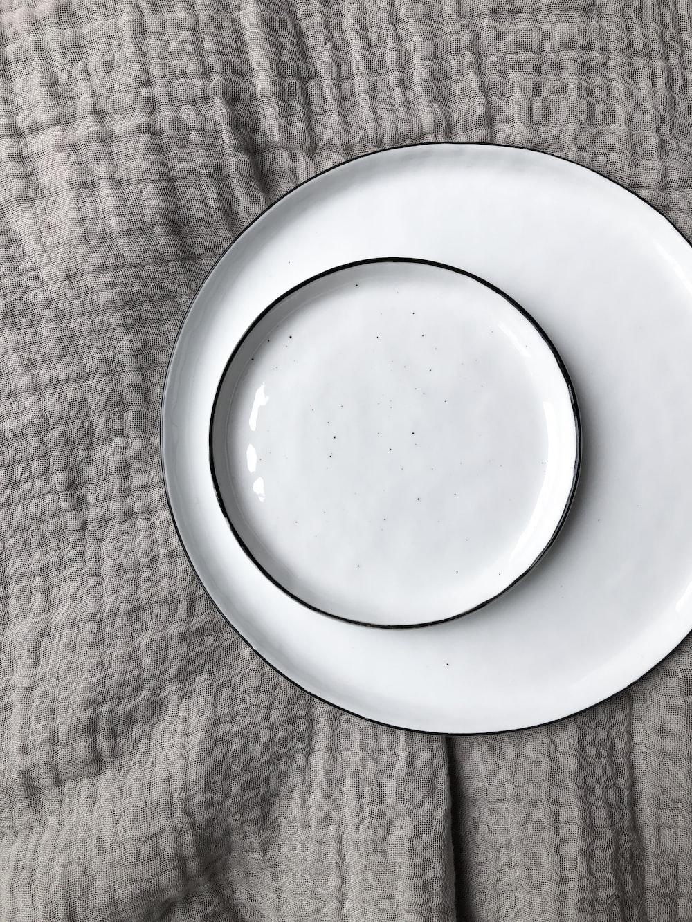 round white ceramic plate and saucer