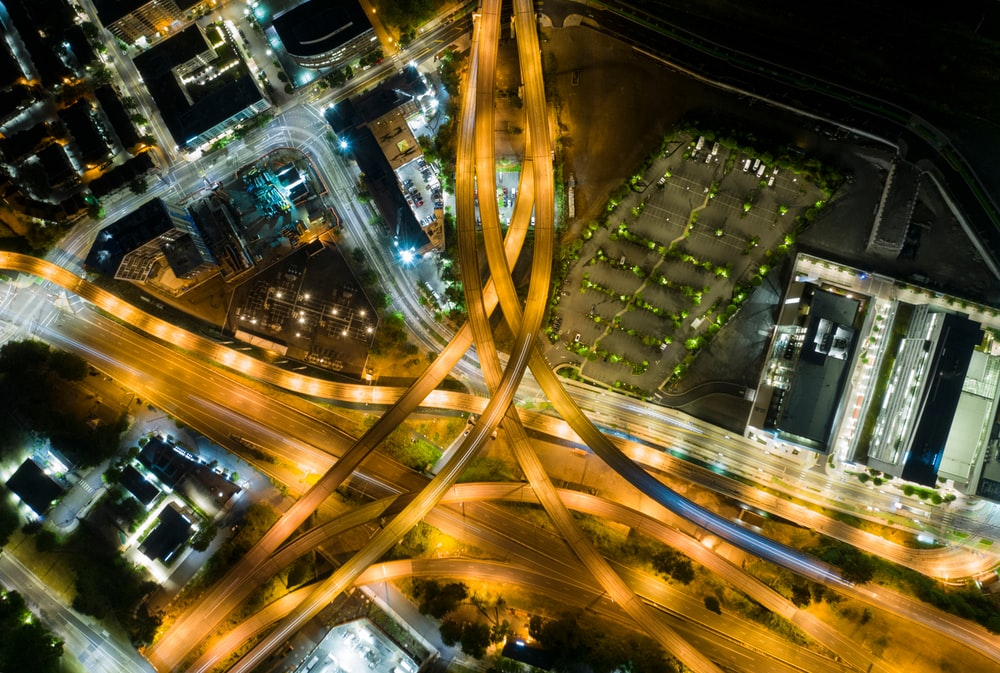 aerial photo of moving vehicles on road at night