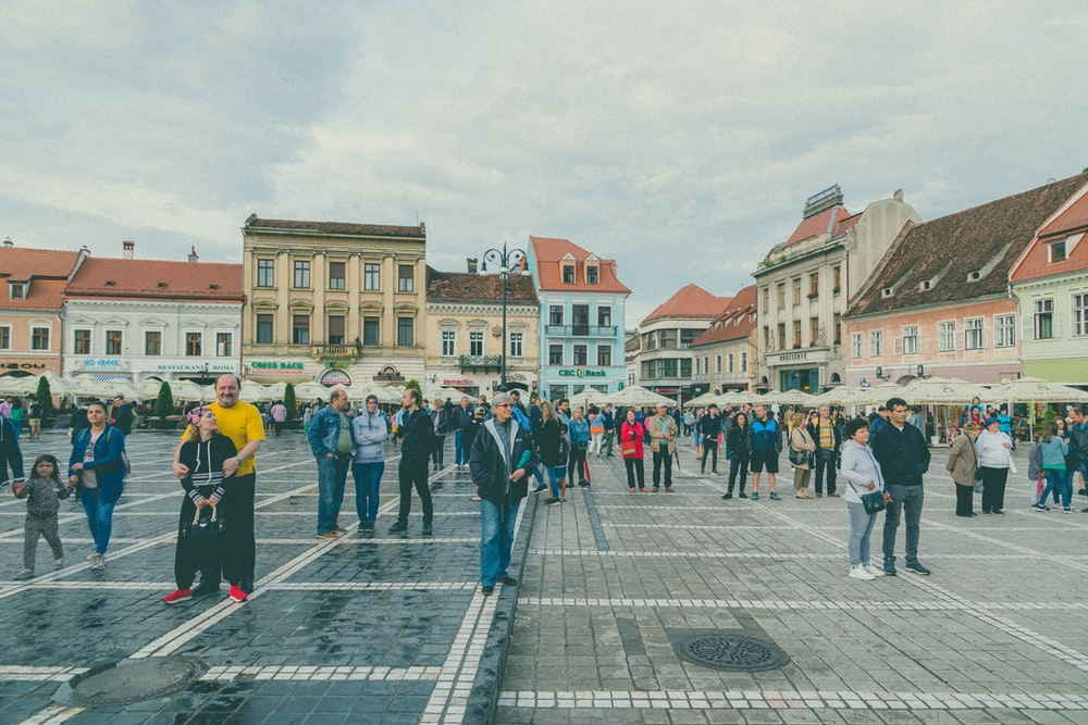 people walking at the town square during daytime