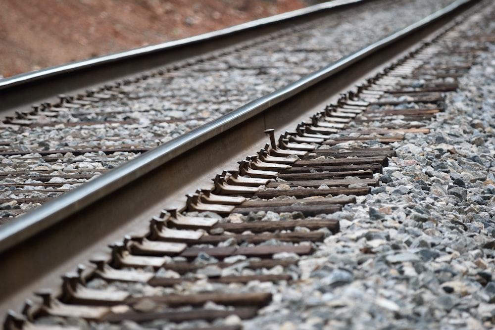 grey metal train track during daytime