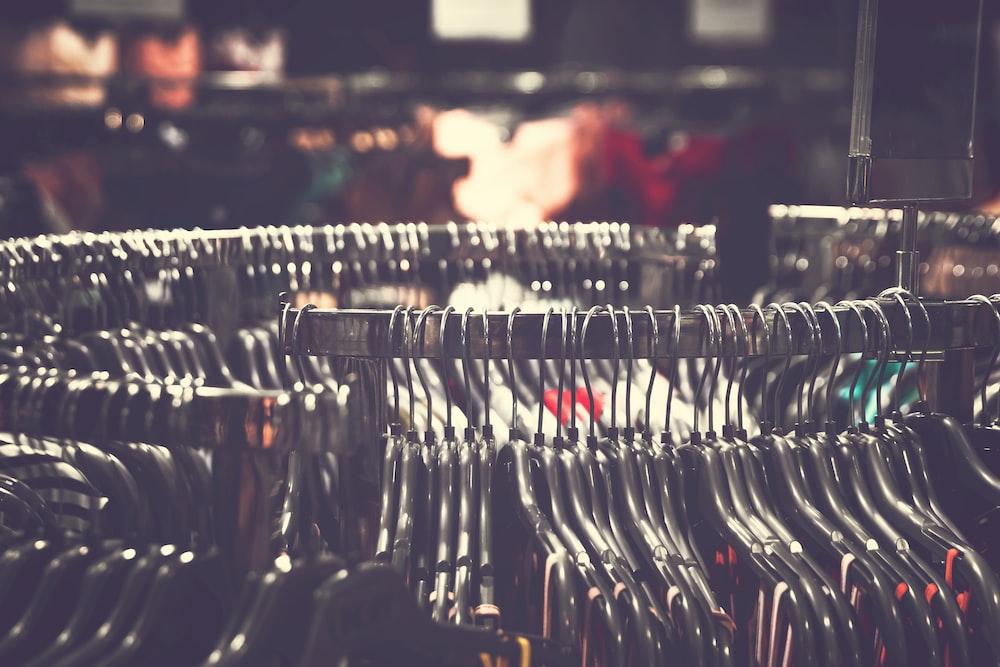 hanged black plastic clothes hanger lot