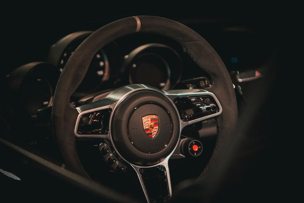 black Porsche steering wheel