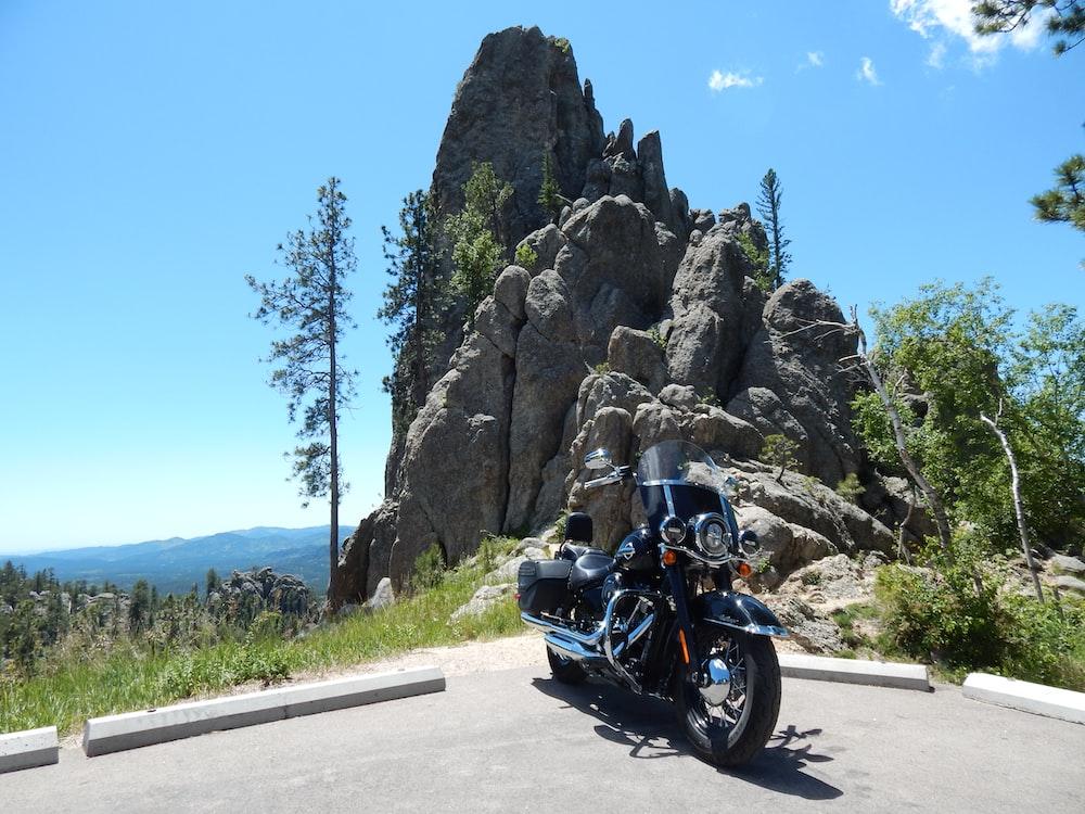 motorbike near rock formation during daytime