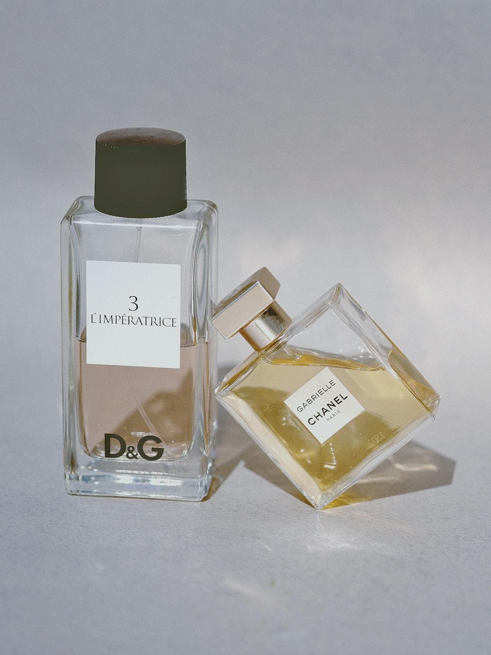 two assorted-label fragrance bottles