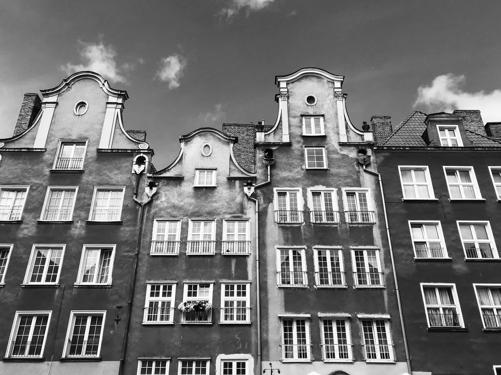 grayscale photo of four buildings