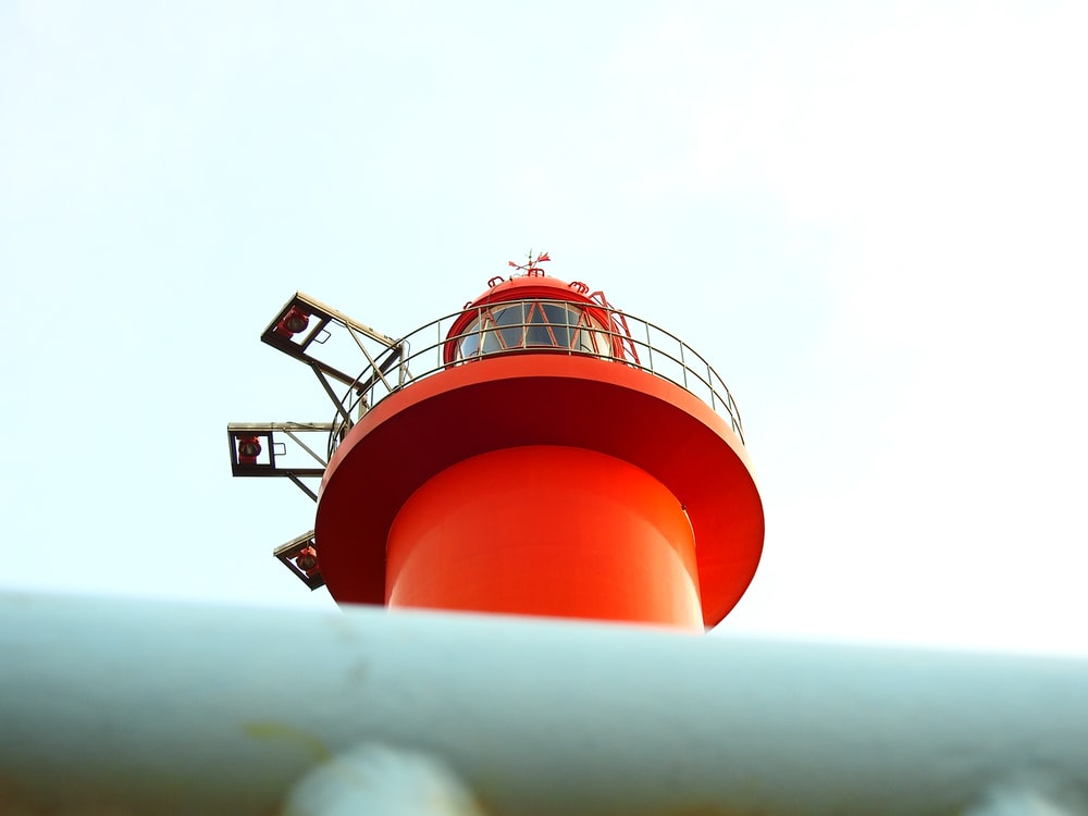low angle photography of orange light tower