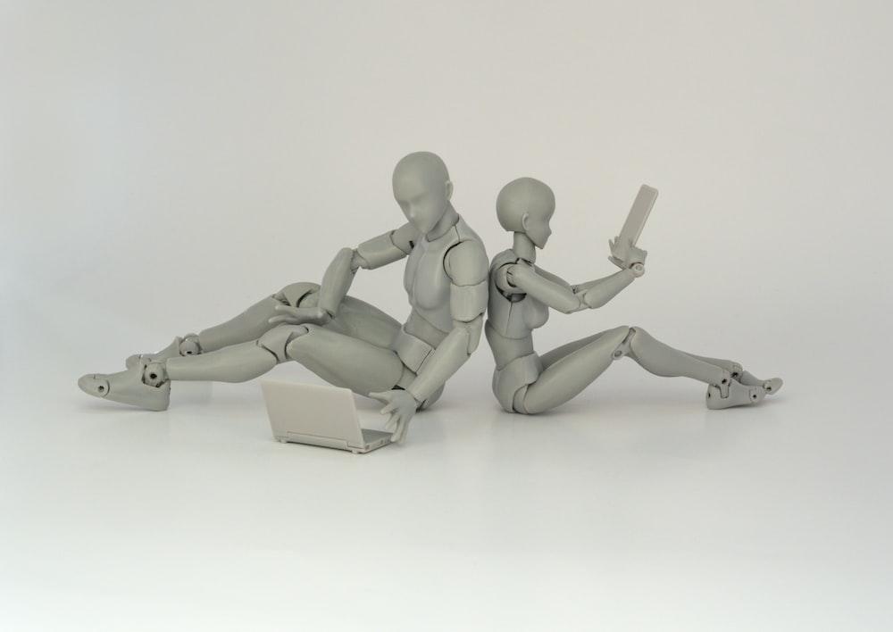 two robot plastic toys holding pistol