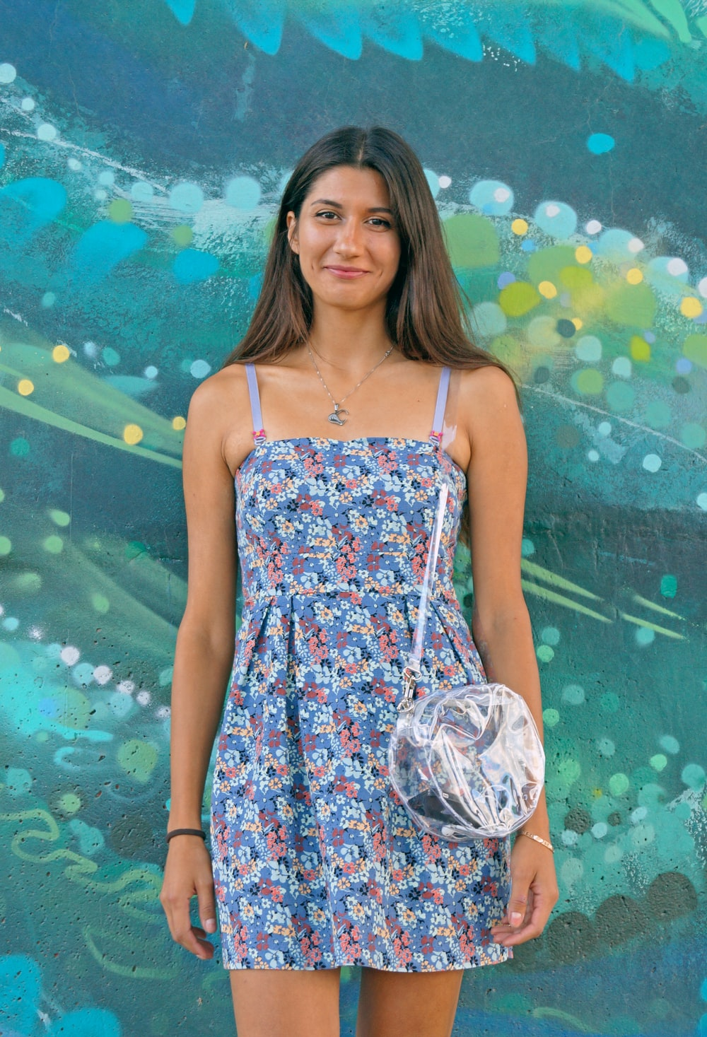 woman wearing blue and white floral spaghetti-strap dress