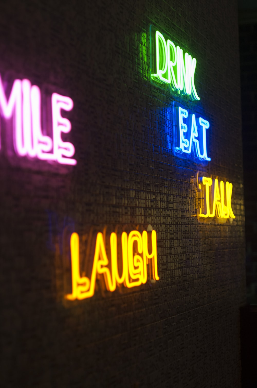neon light signage on brick wall
