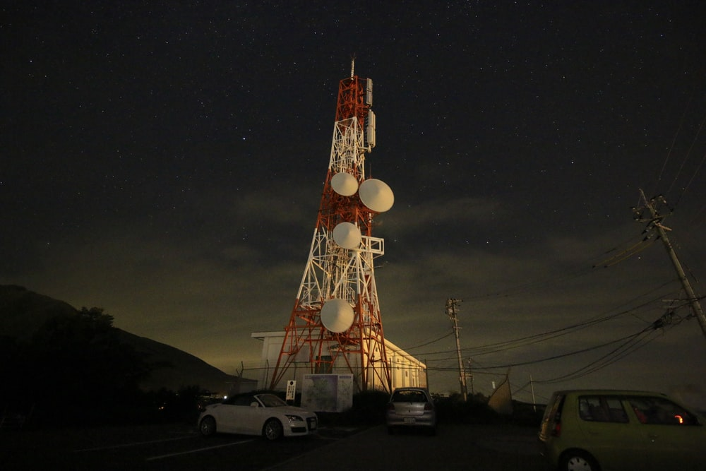 red and white tower during nighttime