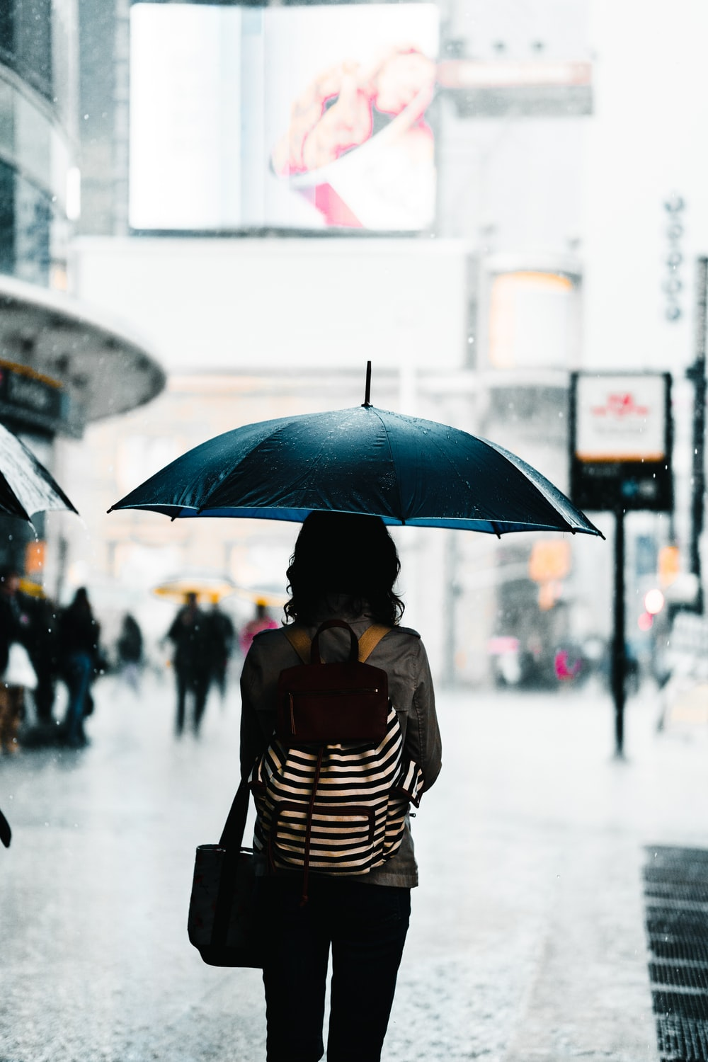 woman standing under umbrella