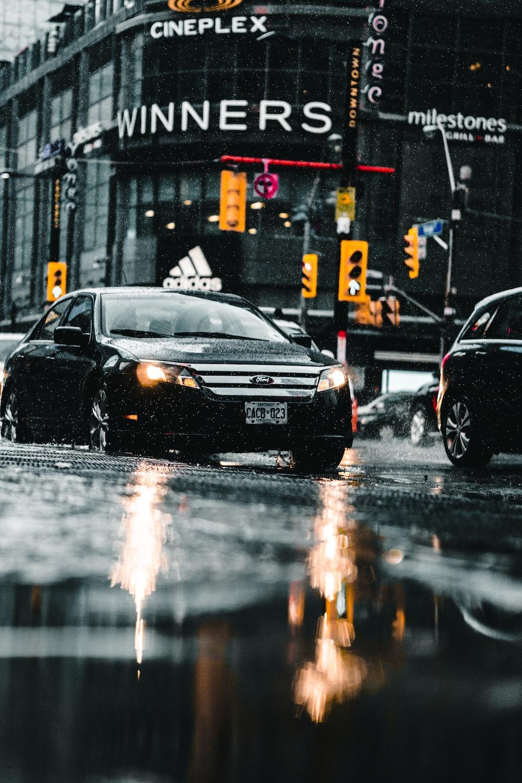 black sedan on the road