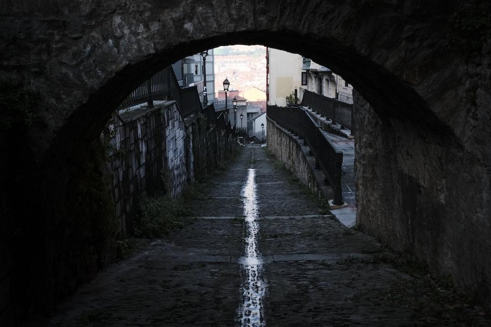 empty walkway under arch