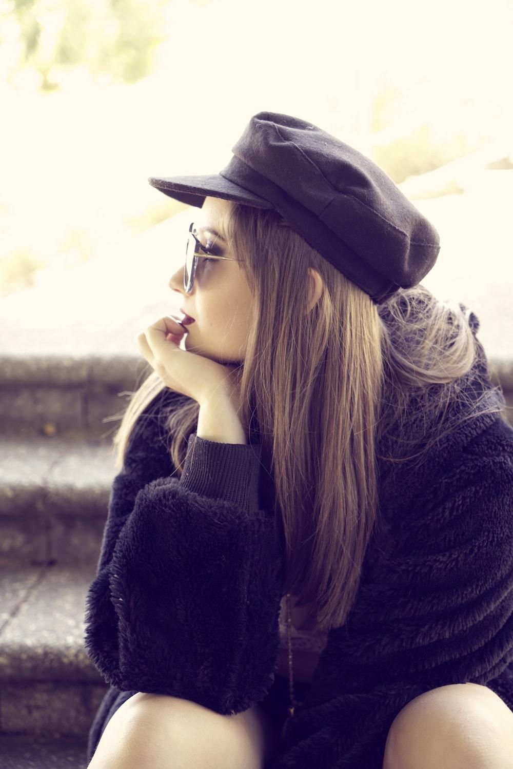 woman wearing black sweater looking side view