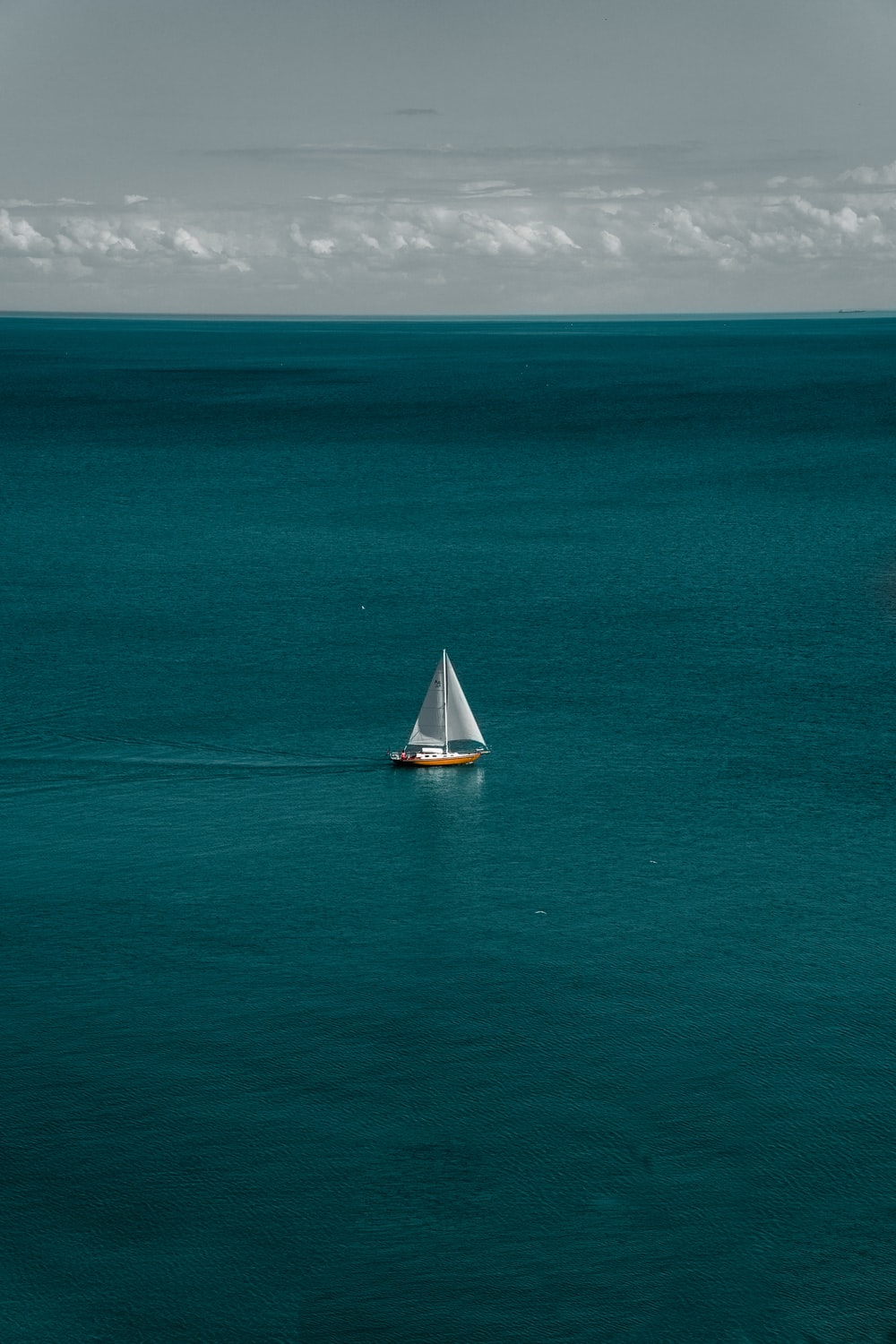 white and brown boat in body of water