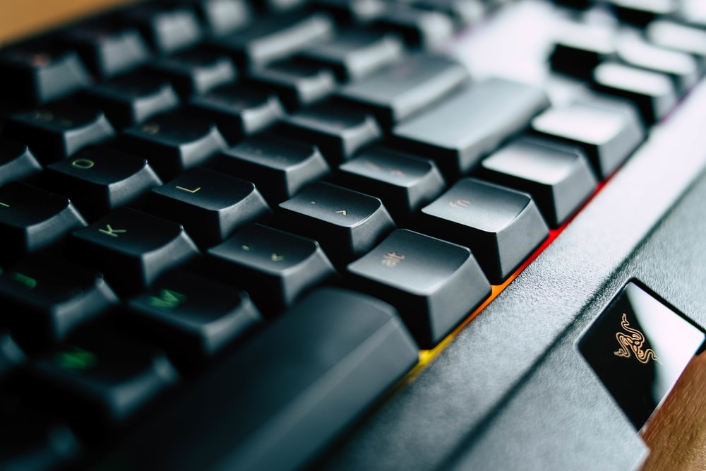 selective focus photography of Razer keyboard