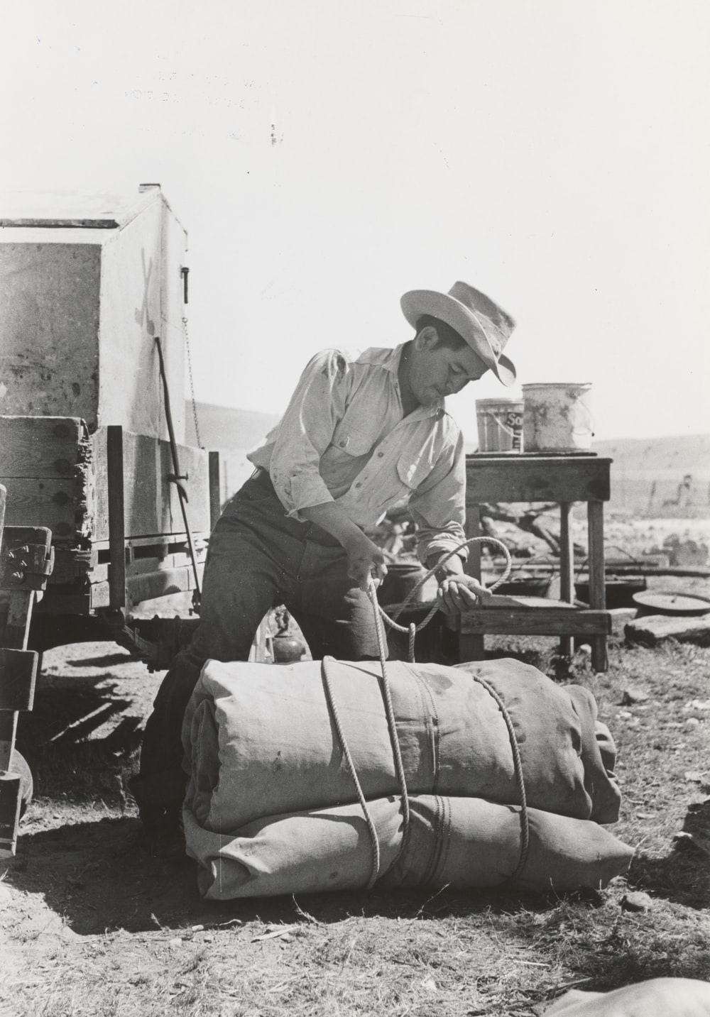 grayscale photo of man wearing cowboy hat