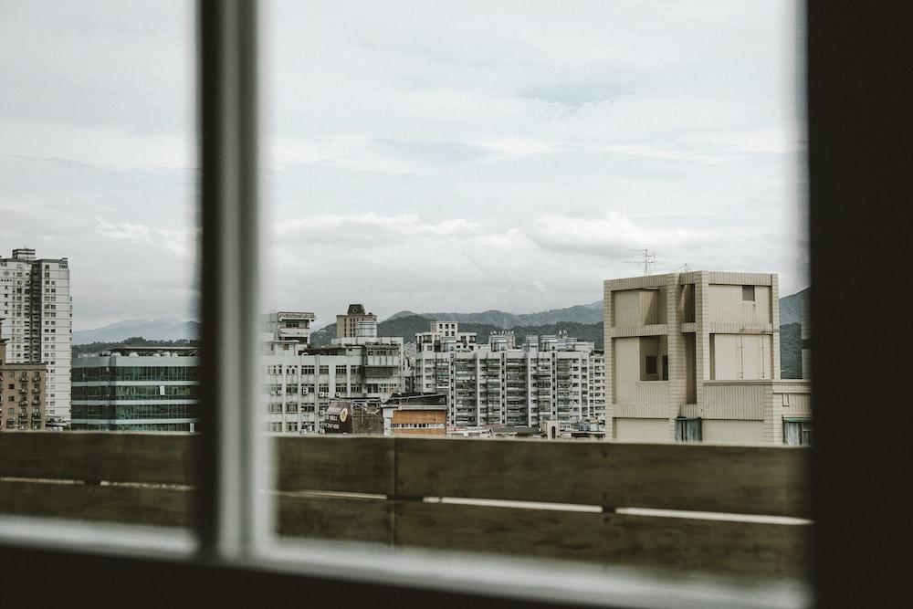 several building seen through glass window