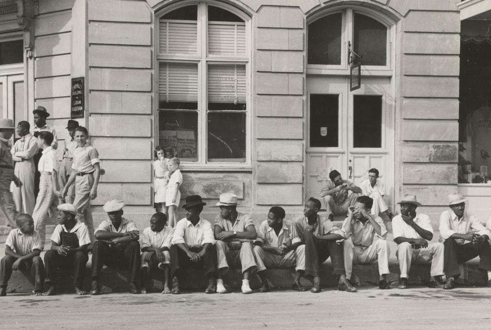 men sitting in front of buildings