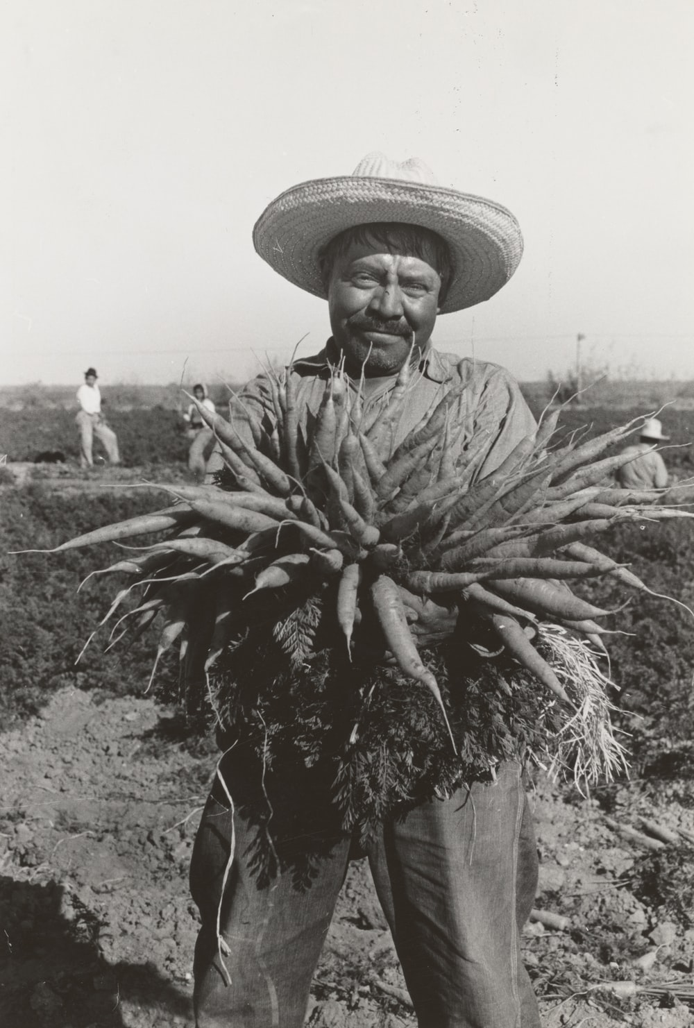 ,man holding rootcrop
