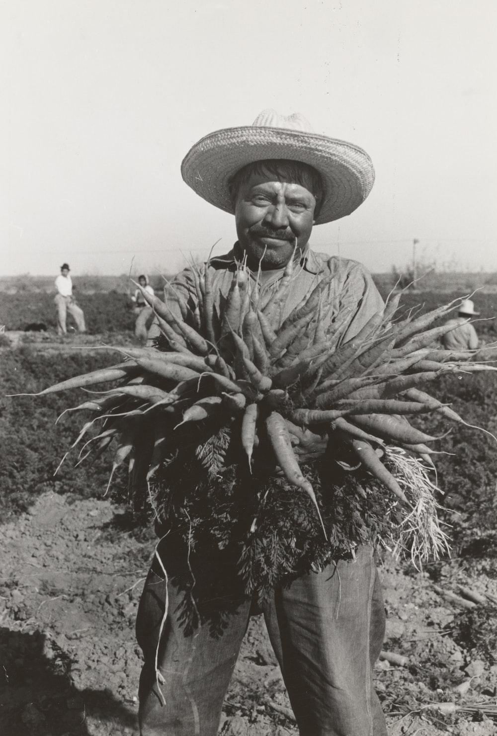 ,man holding rootcrop