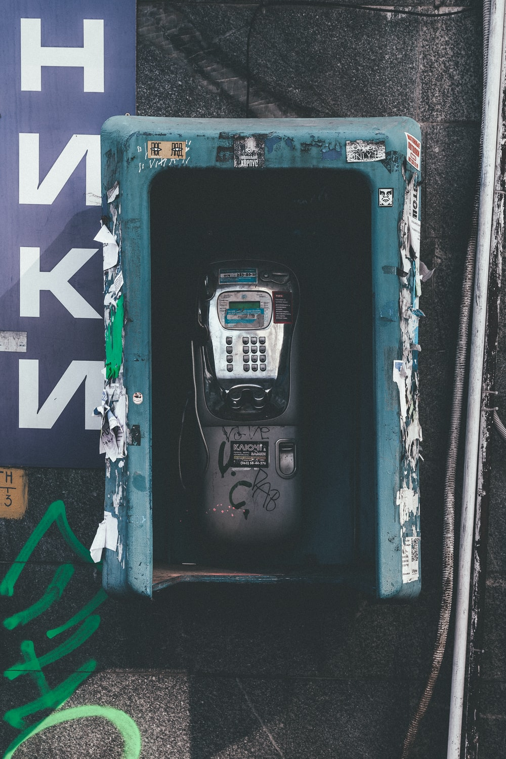 black and gray payphone