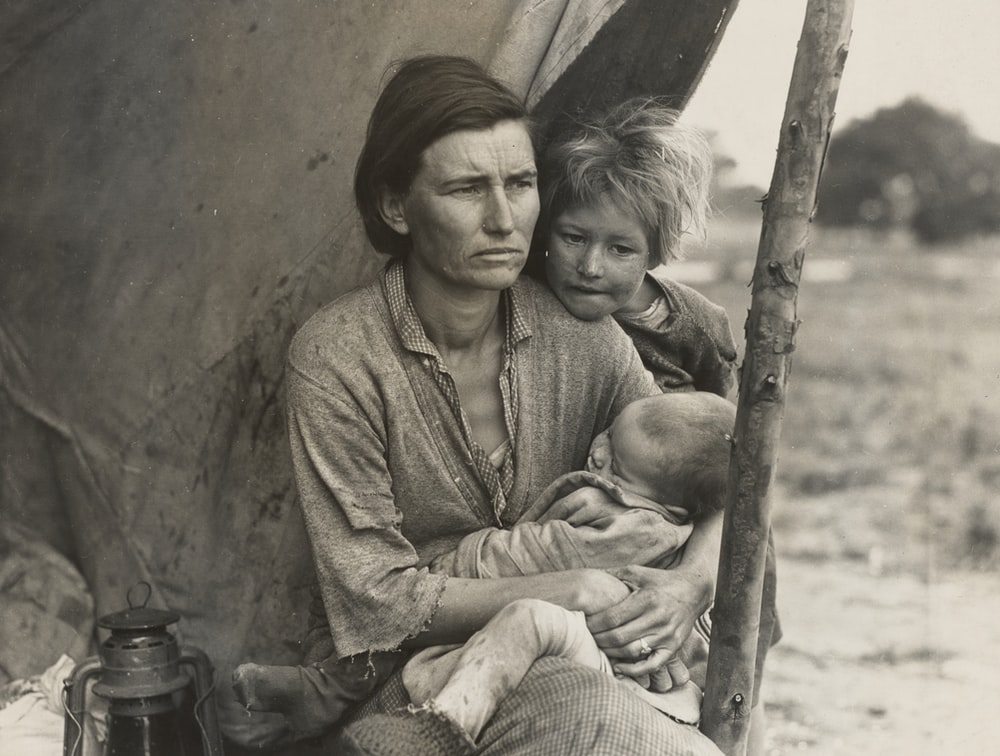 grayscale photo of mother and child