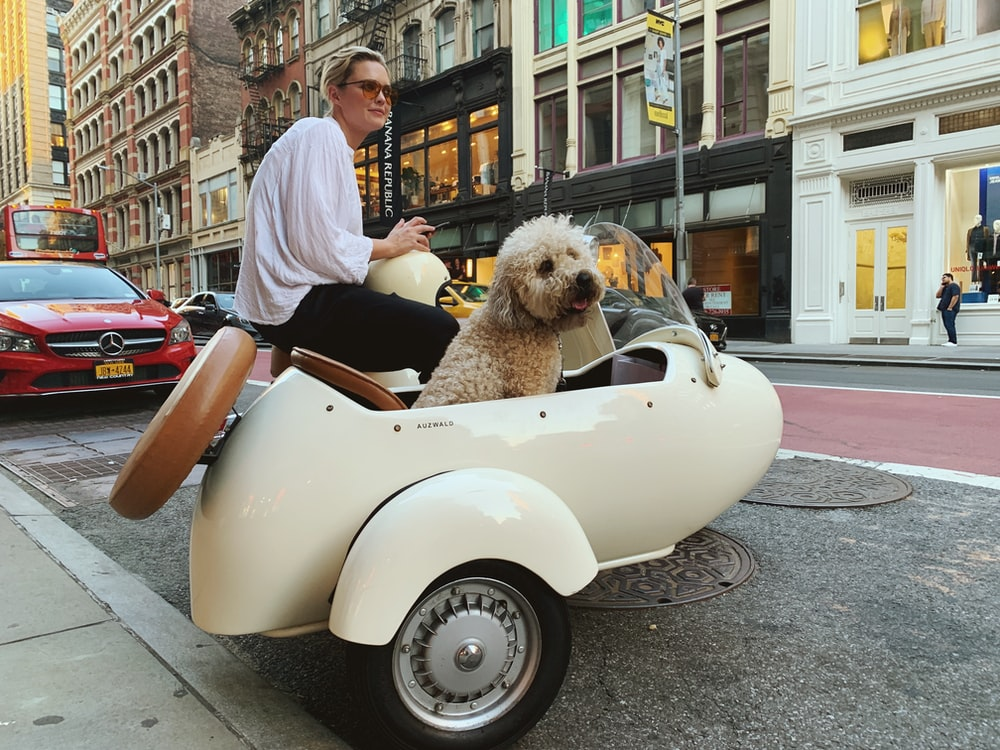 woman riding on vehicle