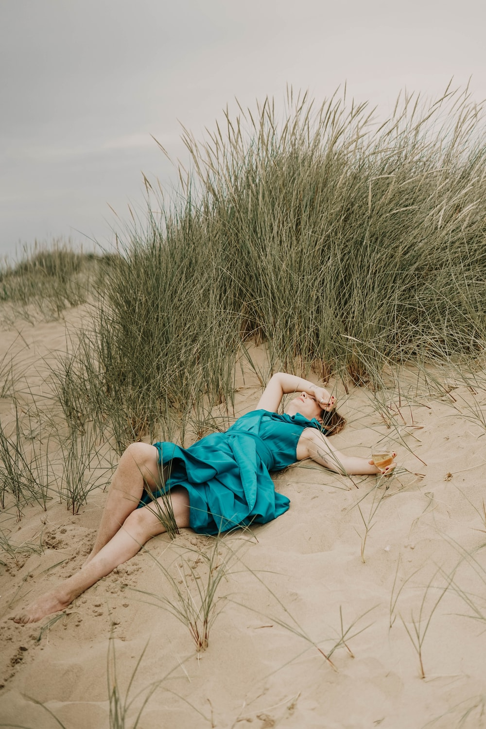 woman laying down on sand