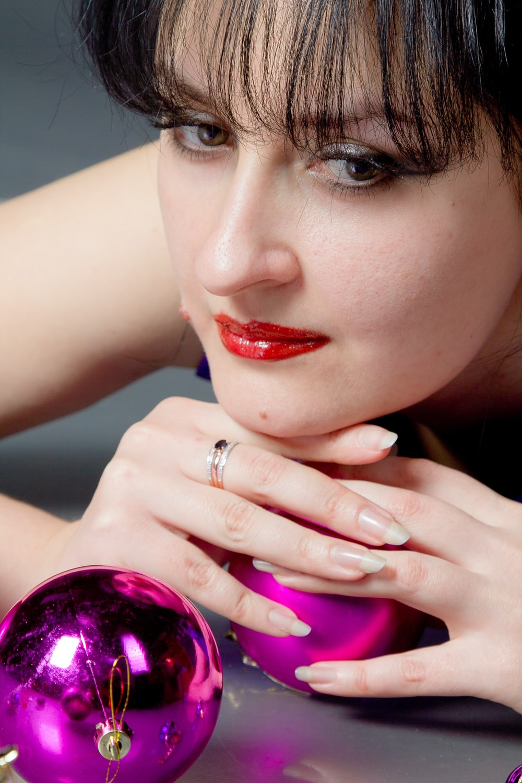woman holding purple Christmas bauble
