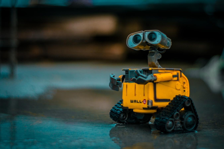 Wall-E looks happily into the sky.