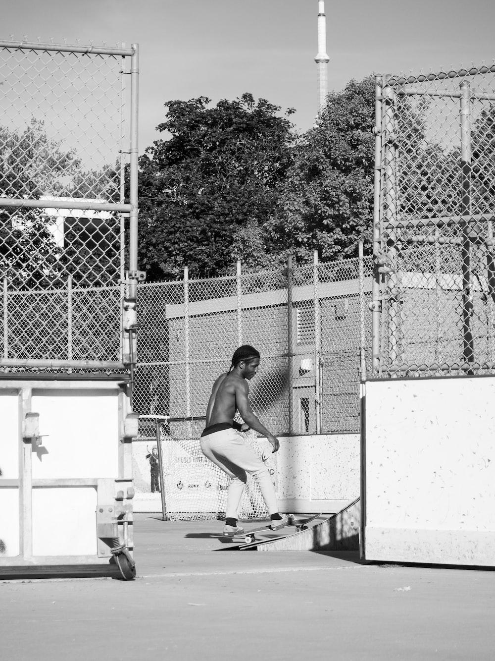 grayscale photo of man skateboarding
