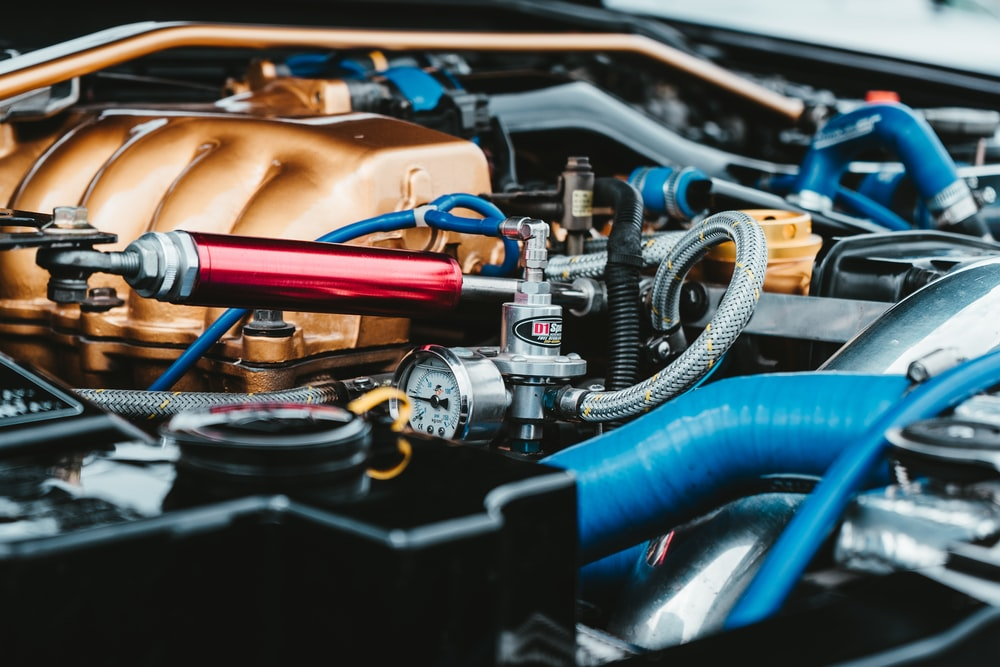 red, gray, blue, and brown car engine