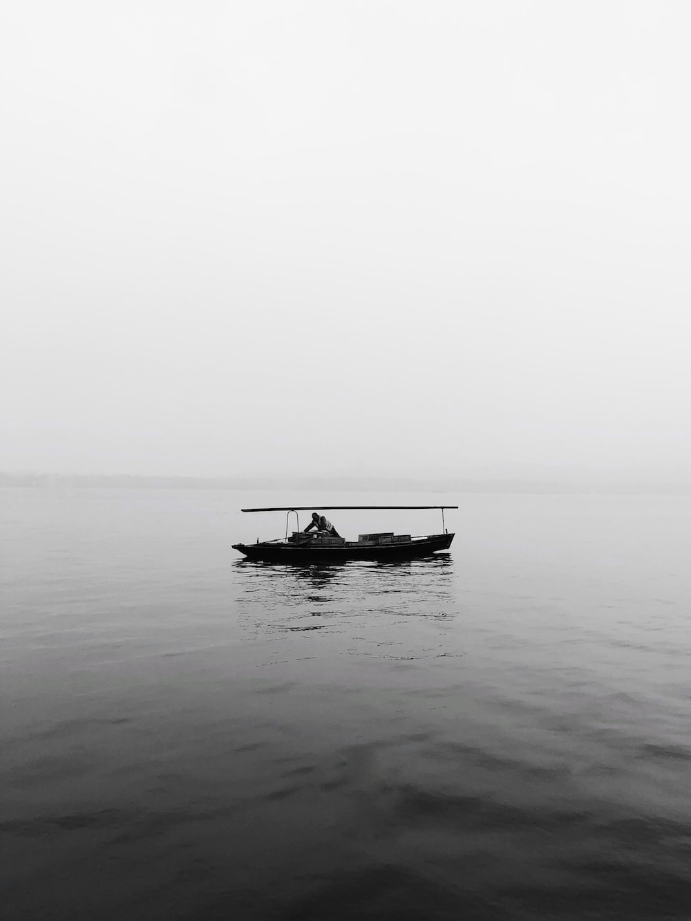 grayscale photography of boat