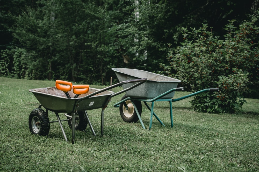 two grey wheelbarrows