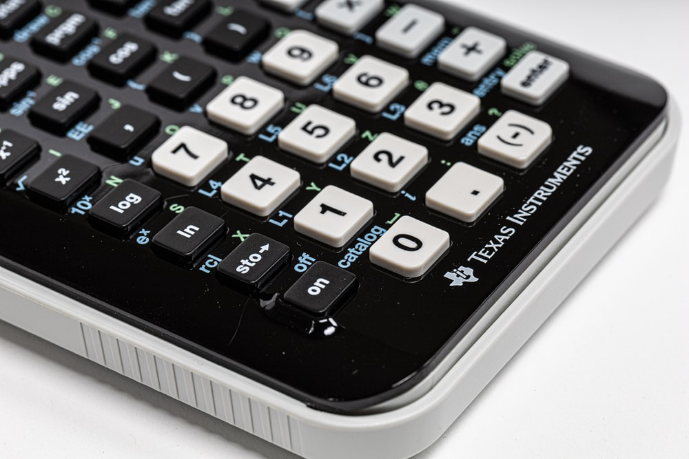 black and white Texas Instruments calculator