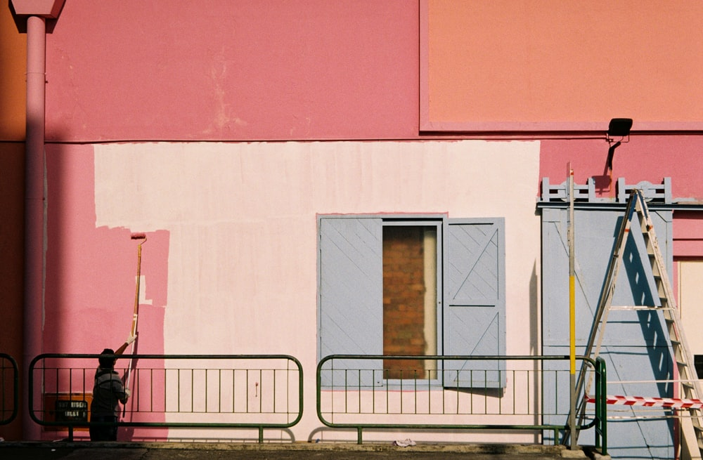 white, pink, and blue paint wall