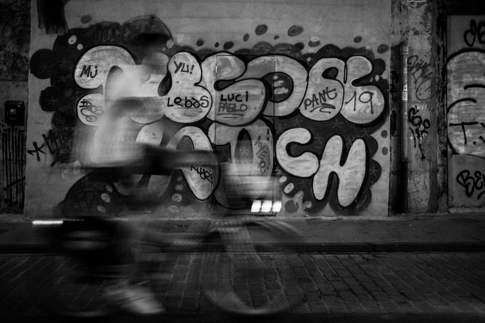 black and gray graffiti wall
