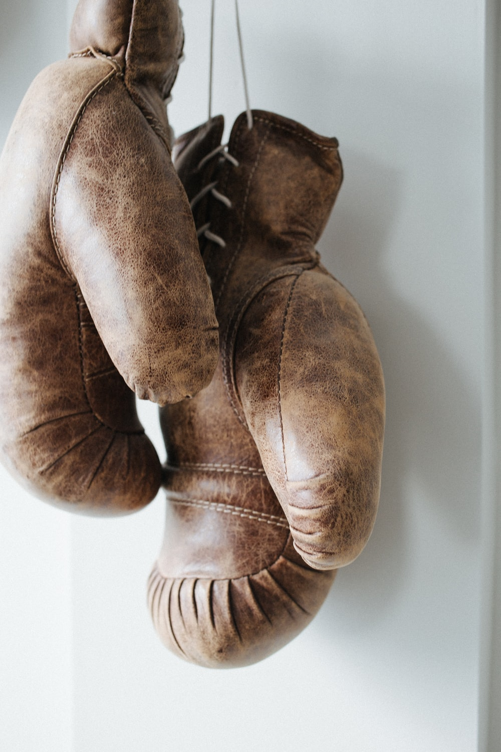 pair of brown leather boxing gloves