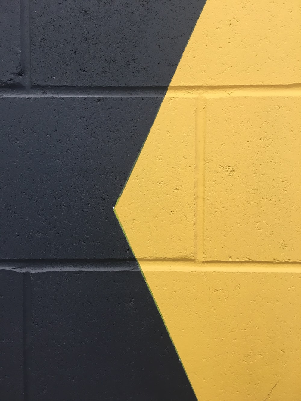 black and yellow paint wall