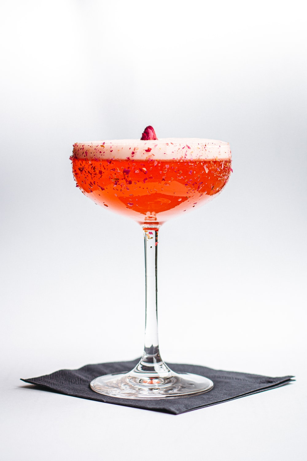 orange cocktail on a footed glass