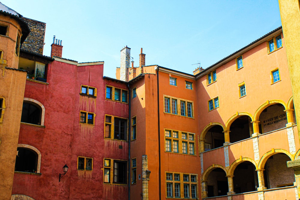 red, orange, and yellow concrete buildings at daytime
