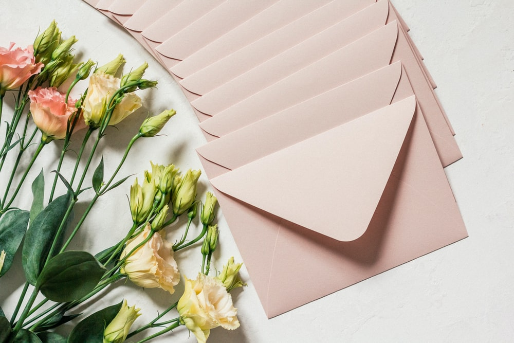 flowers and envelopes on white surface