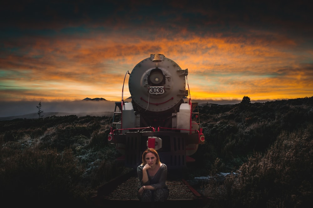 woman in front of a train