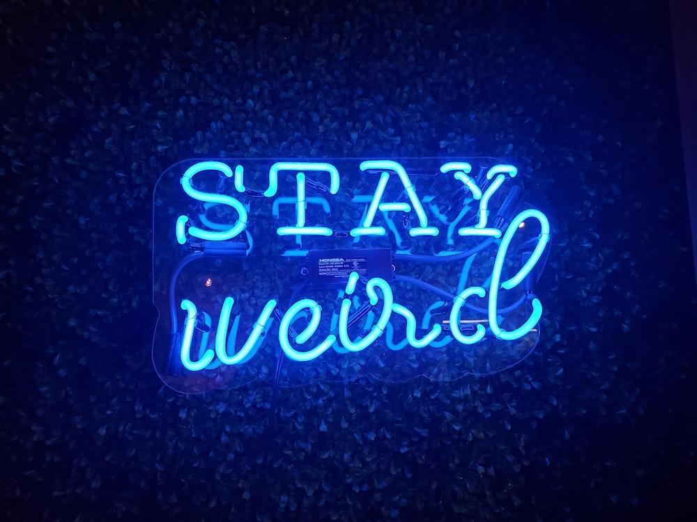 blue Stay Weird neon light signage