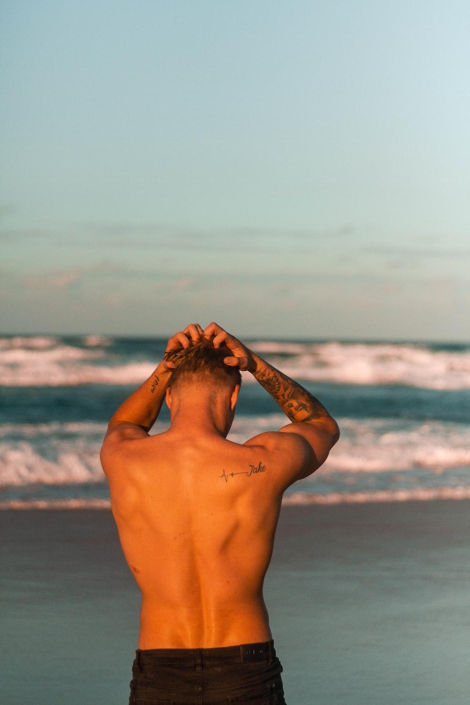 man standing near beach