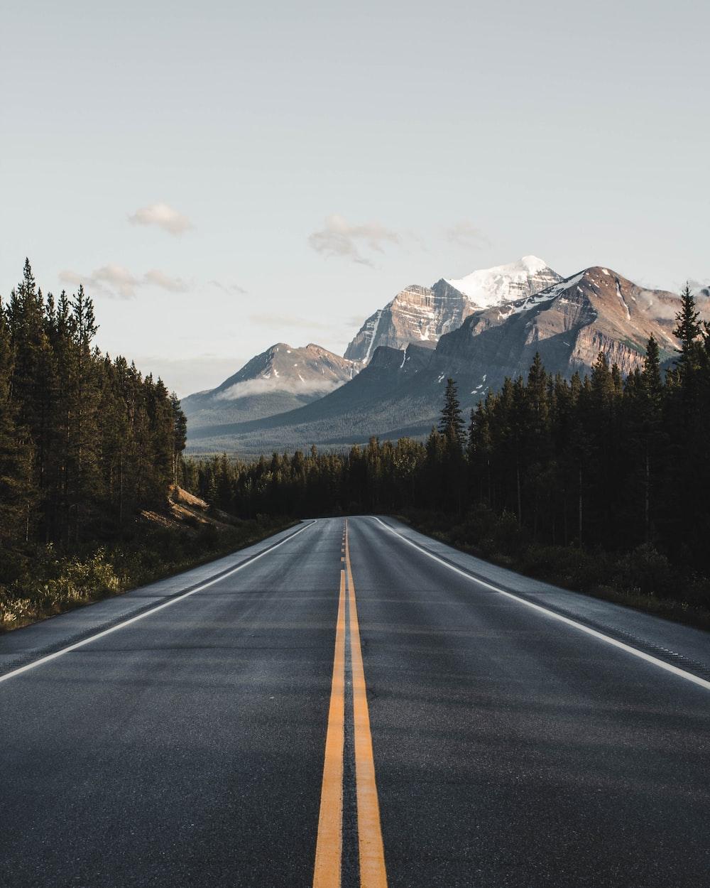 wide road under blue sky