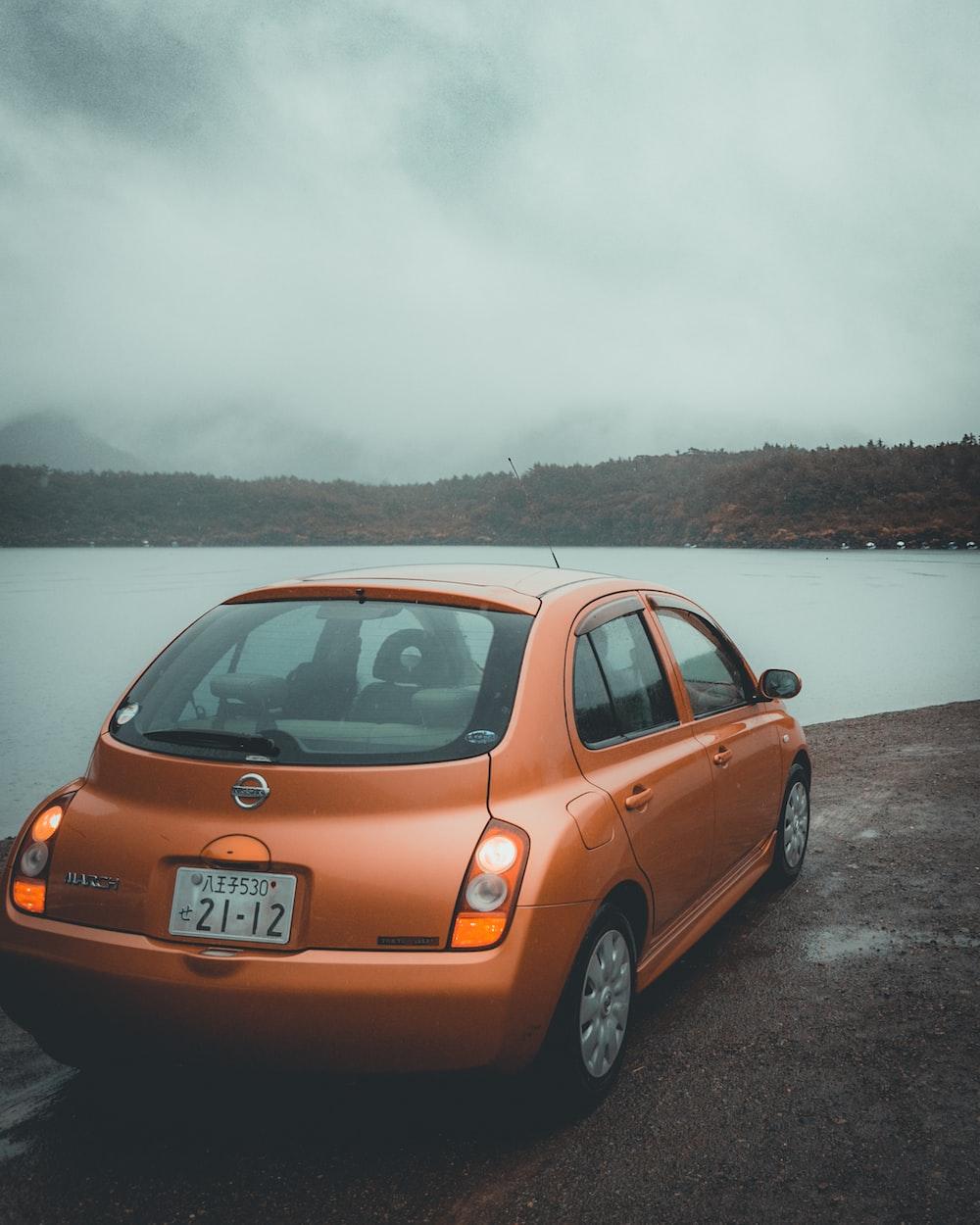 orange Nissan 5-door hatchback