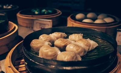 dumplings on steamer dumpling teams background