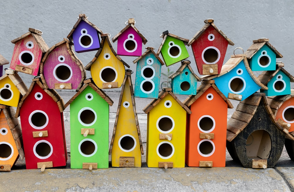 assorted-color wooden birdhouses